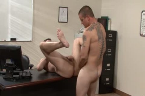 Tattooed homosexual guys plowing In The Office