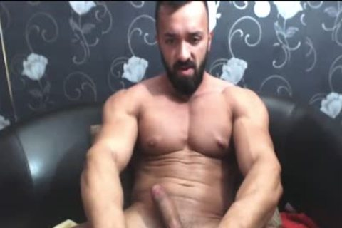 Bearded brawny guy Strokes His large cock