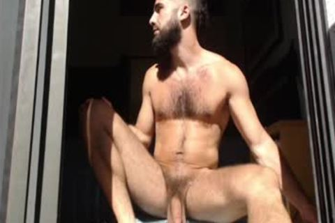 Bearded dude Massages his nuts